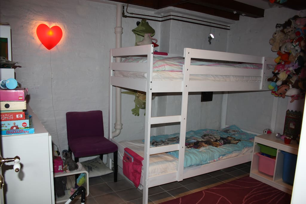 Childrens' bedroom with full-size bunk bed