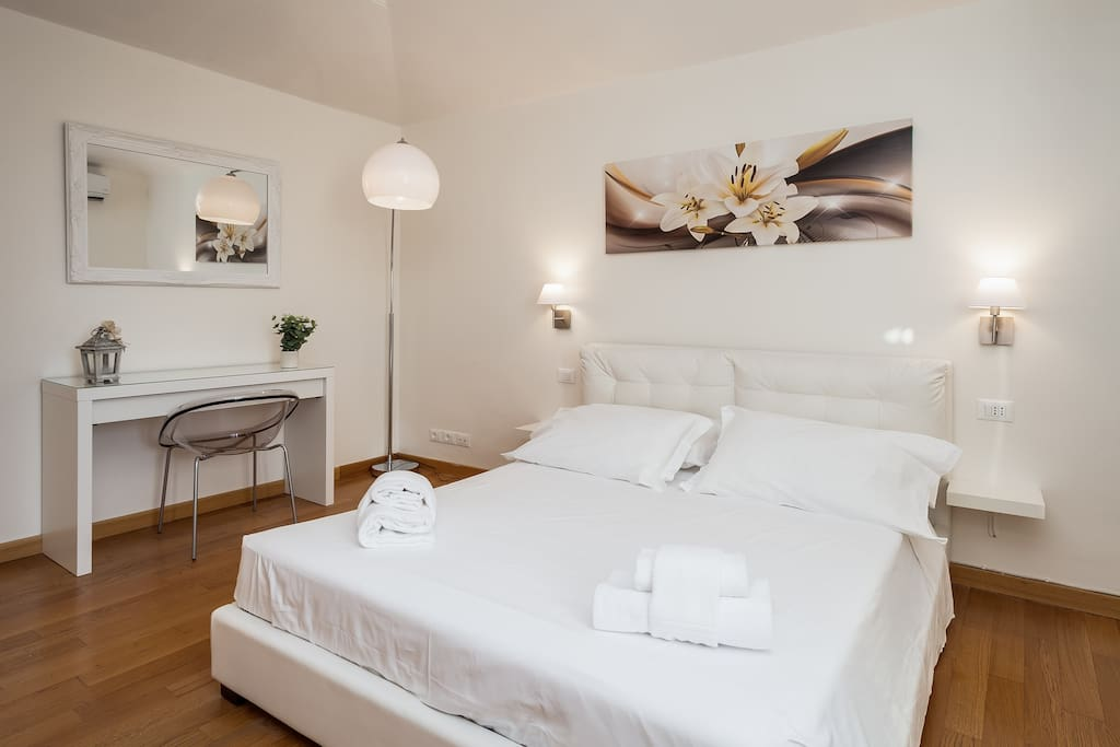 First bedroom with a wardrobe and an amazing view of the top of Spanish Steps , St.Peter's and Quirinal