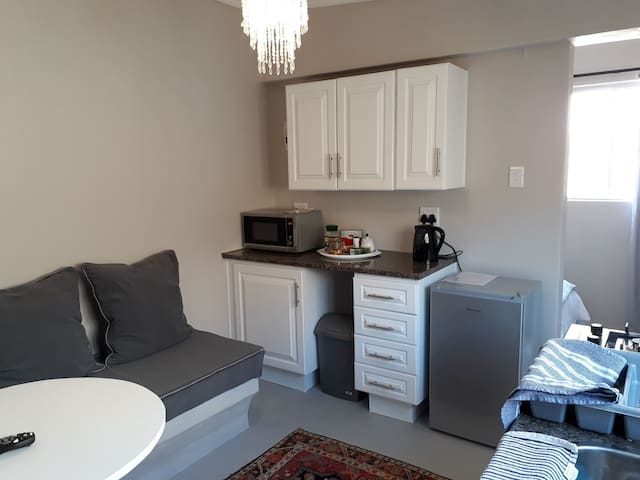 Kitchen complete with cutlery  and crockery and Dining area