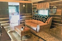 Kick back in the Living Room's suede recliners with a beer. Featuring USB charging, 46 in. flat screen, stereo.  Sit at the marble counter tops for a quick bite or coffee.  All furnishings are new;  but casual and rustic for the guys in your party.