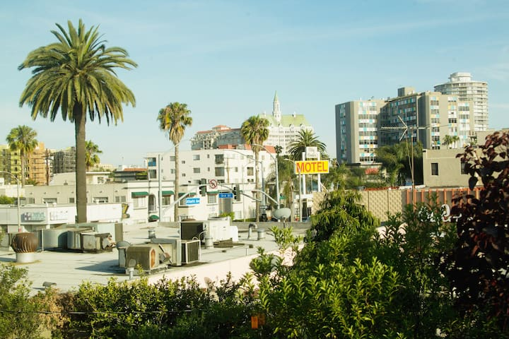 Postcard view from the loft. -DTLB Arts Village and Ocean