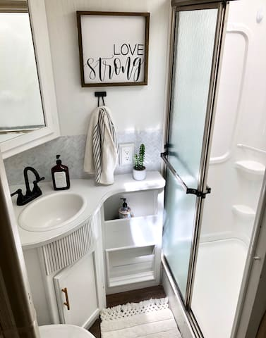 Bright and Cheery Bathroom with Shower