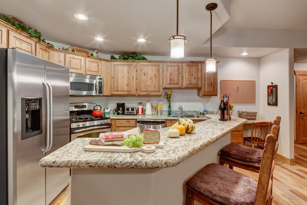 Gourmet open kitchen with breakfast bar seating
