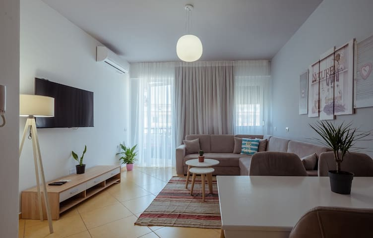 This is the living room. Everything is new and very well thought to create a relaxing environment.