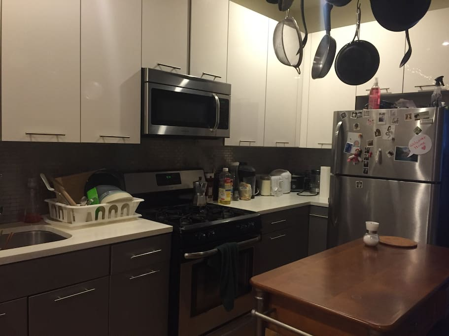 Modern appliances and a lot of pots and pans