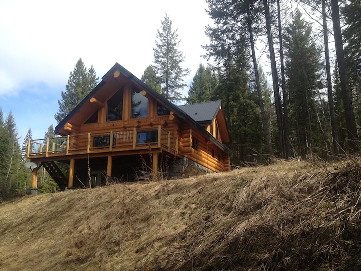 Golden Log House above the Valley