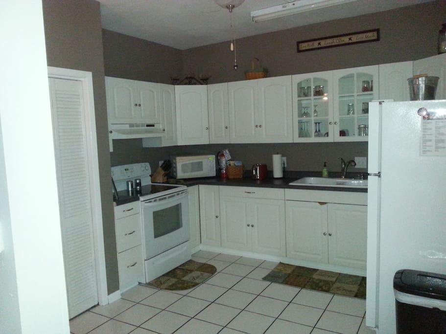 Large fully stocked kitchen.
