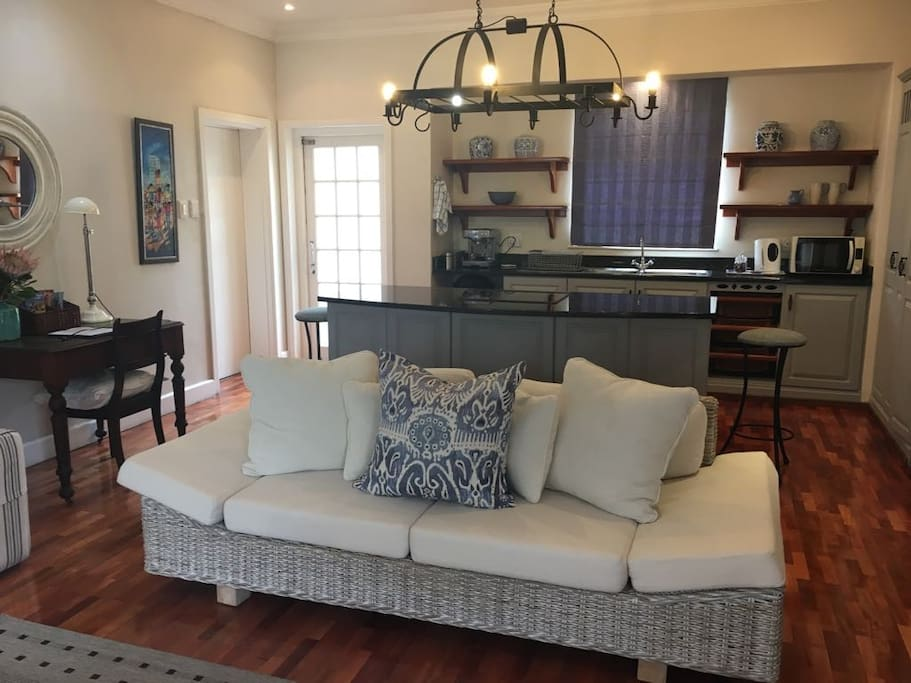 Open plan lounge with fully equipped kitchen
