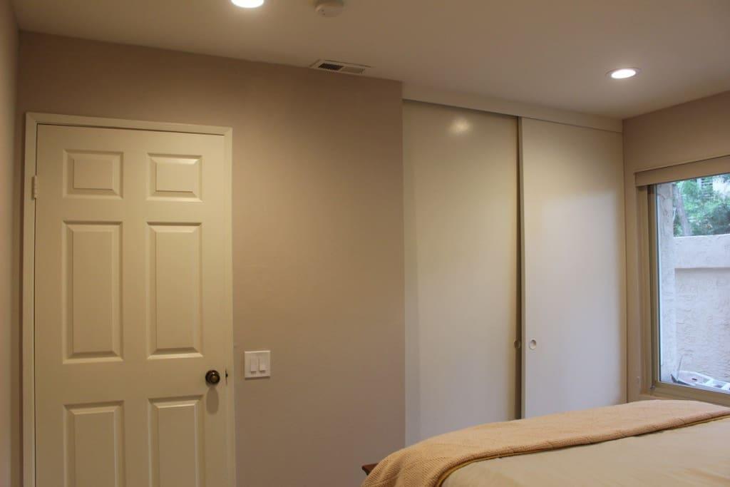 Closet space with interior dresser.