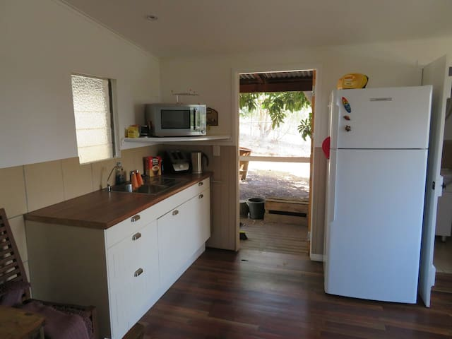 Kitchenette with full sized fridge. Cooking with convection microwave oven and outdoor bbq.