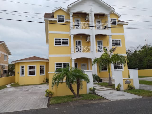 Two beautiful 3 story townhouses on premises.  The one bedroom, one bath apartment is attached to the townhouse - on the left.  Destiny's Place.