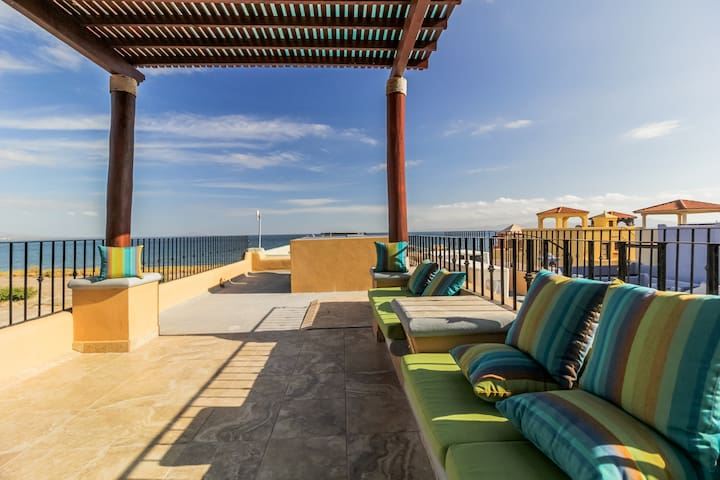 Colorful coastal retreat with sweeping ocean views, huge patio, & shared pool