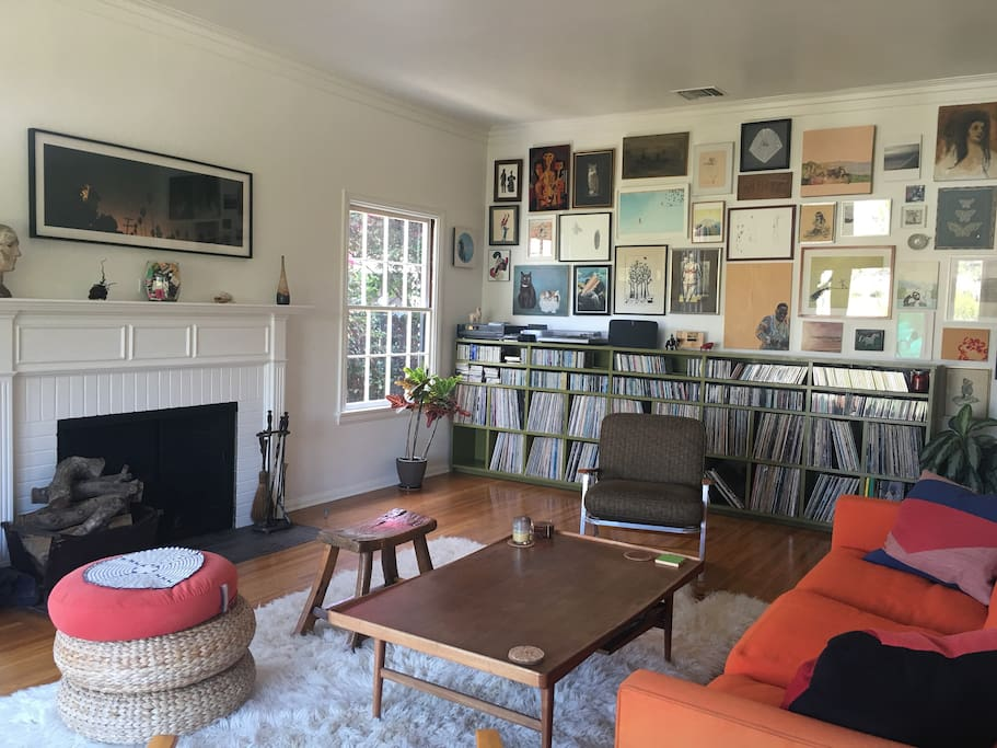 livingroom with fireplace, records and art