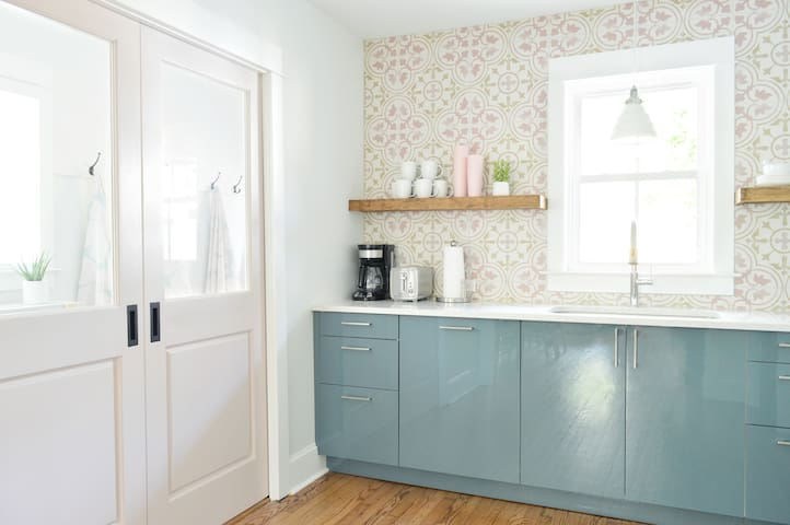 Cheerful new kitchen with updated appliances & cooking supplies