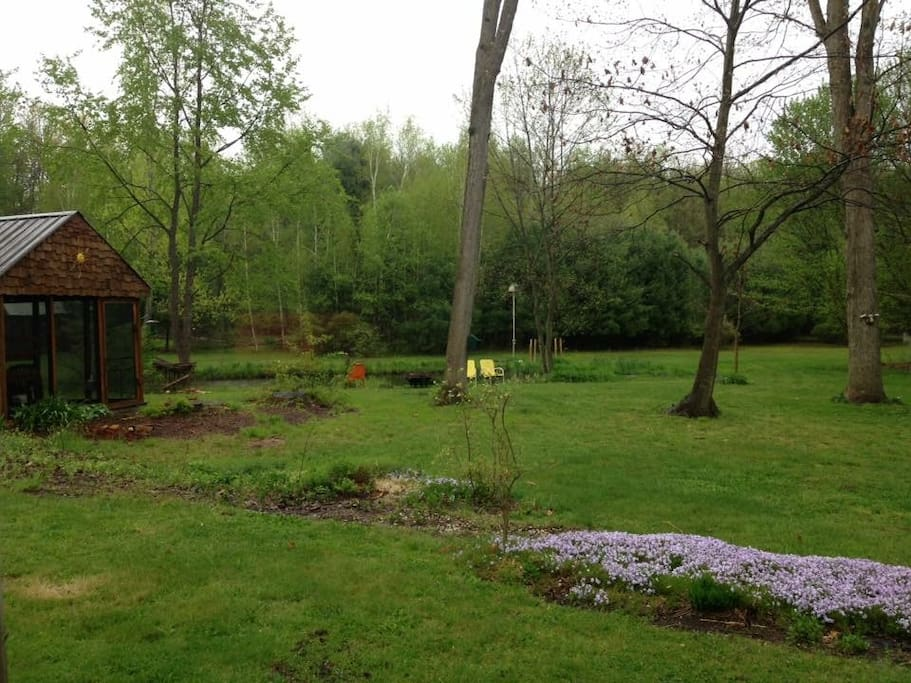 Back yard with pond and screened in porch