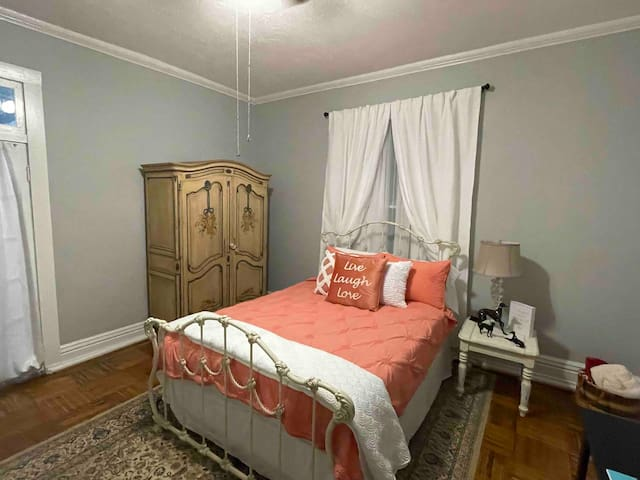 One of the 2 bedrooms with a queen bed with memory foam and nice linens.  Armoire has drawers to utilize if you desire and extra blankets if you need them.  There is a beautiful non-working fireplace in this room and a desk to work at.