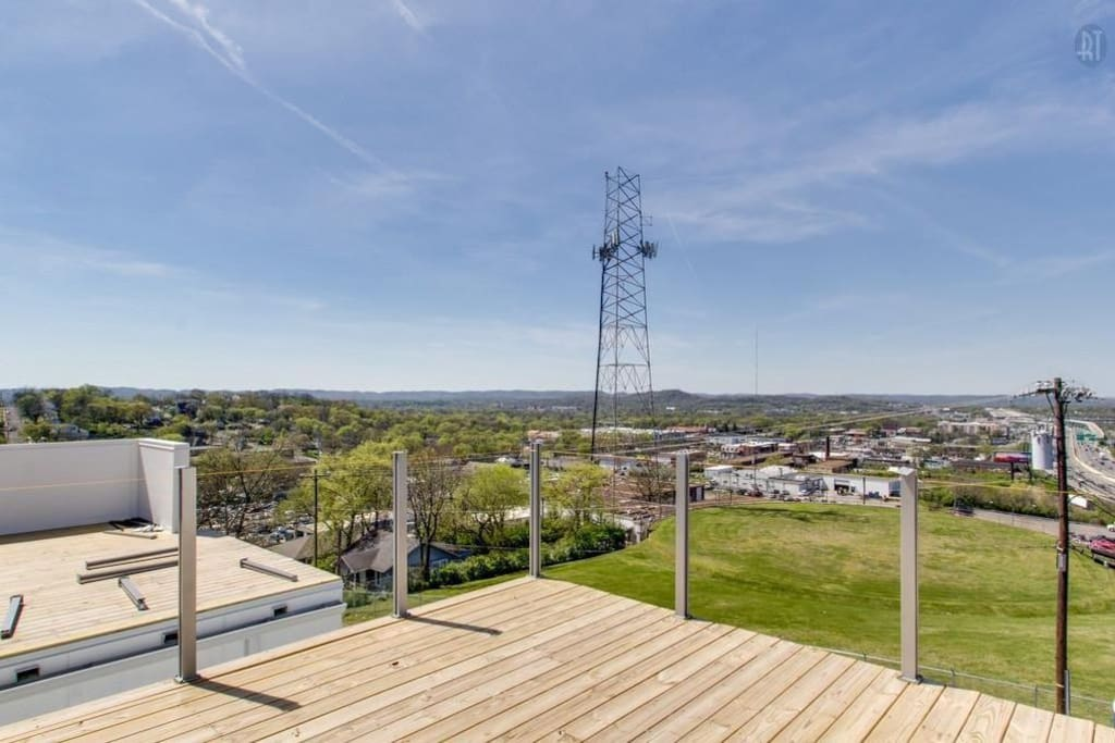 This house has two roof top decks. One overlooks the country side and the other overlooks the city side.