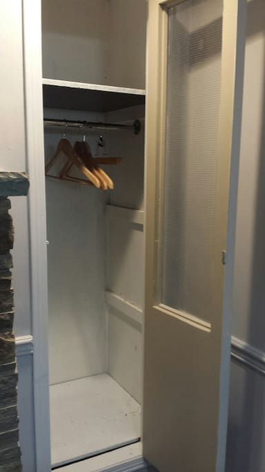 As well as a clothes rack, there is a closet in the room