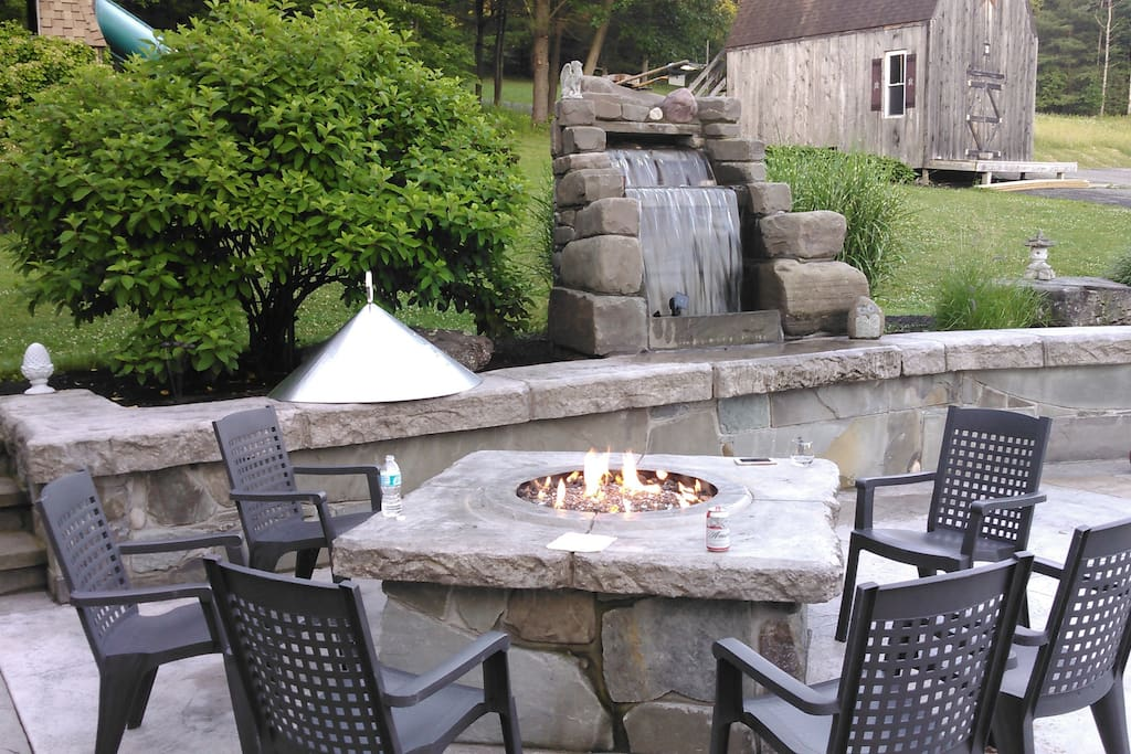 Large patio with gas fire pit and waterfall. For your enjoyment.