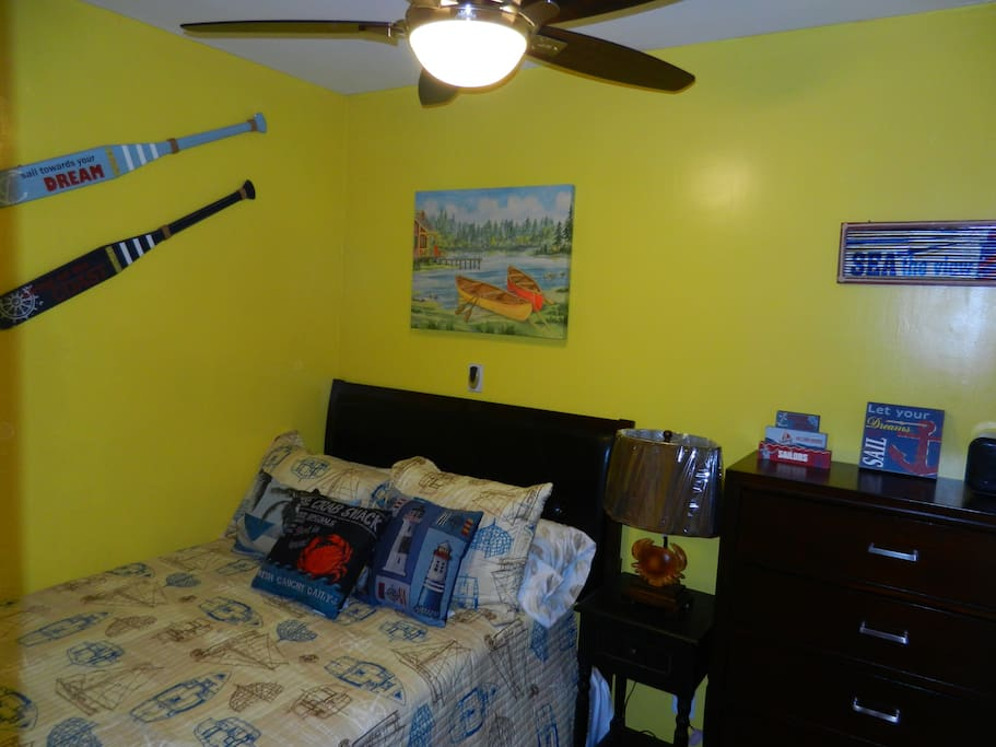 The other bedroom is a cozy nautical   bedroom with a super comfortable double size bed.  Accommodates up to 2 guests.