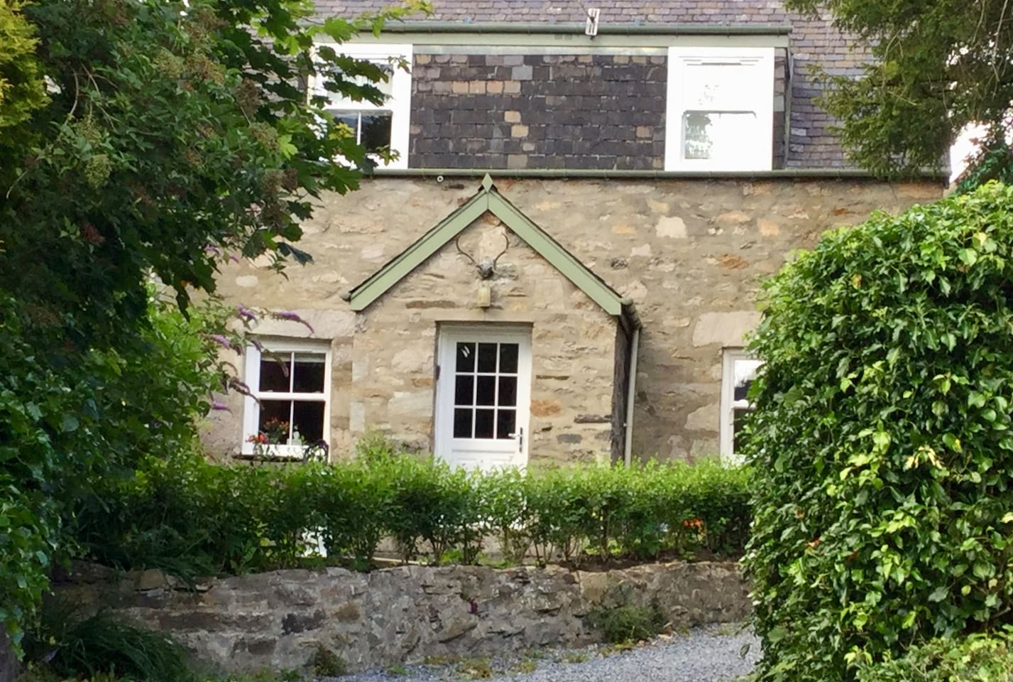 Front View of the Lodge , traditional stone cottage.