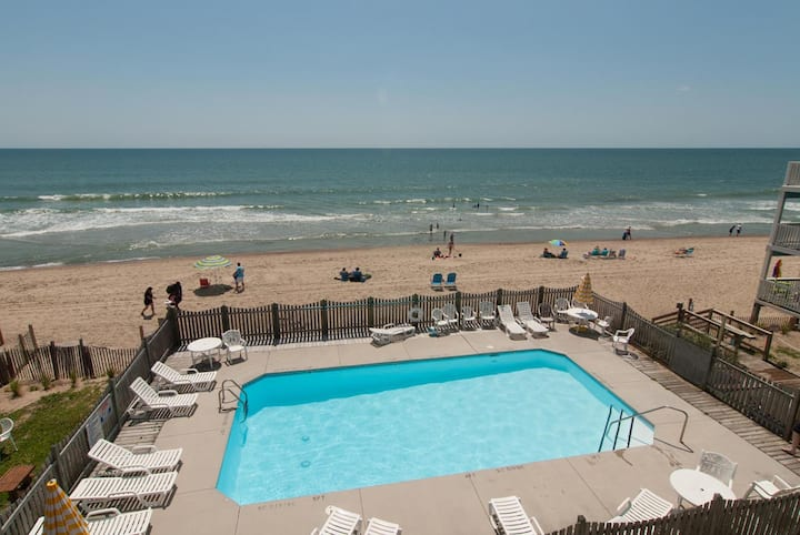 Rudicile-Overlook both the pool and the sandy beaches from this oceanfront condo