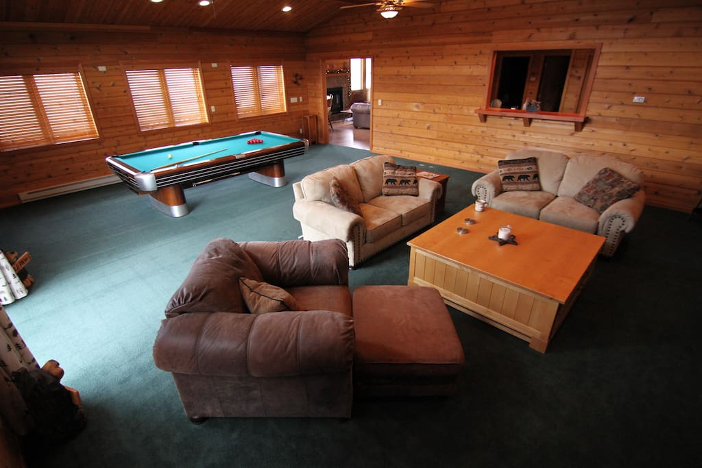 The living room is a great place to hang out!  It features a vintage Brunswick pool table, fire place, and 70 inch UHD TV!