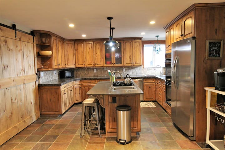 Create a gourmet meal with double ovens, gas range top, and double sinks. Everything you need is right here.
