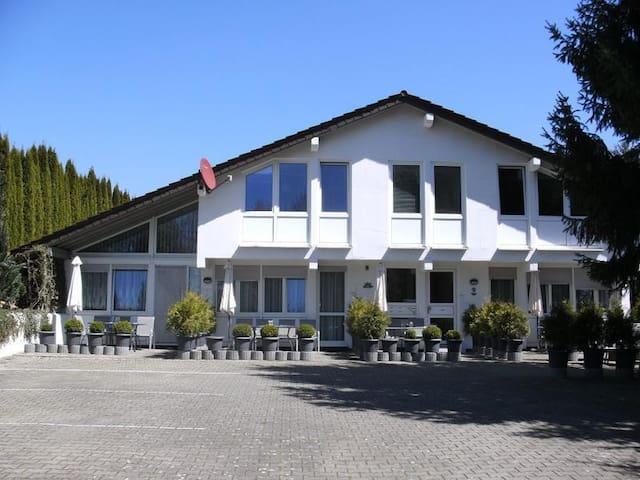"""Cozy Studio Apartment """"Ferienwohnung Trapp-Mayer UG Links"""" near Lake Constance with Wi-Fi & Terrace; Parking Available, Pets Allowed"""
