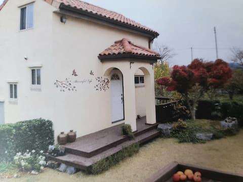 House with Persimmon field near Tamjin riverside