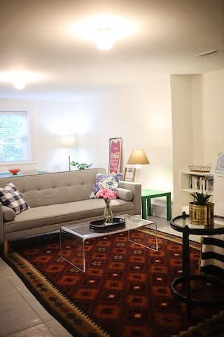 """living room with sleeper sofa; 37"""" TV is off to the right (not shown here)"""