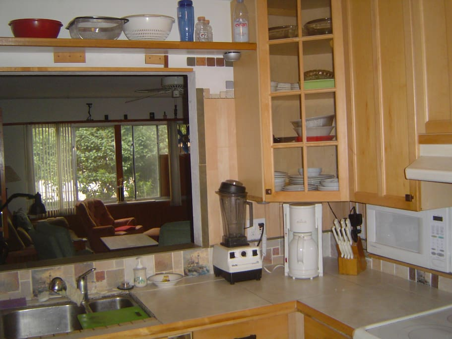 KITCHEN:  Sink pass-thru, Vita-Mix blender,  coffee maker, microwave shown.