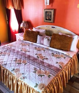 Rest easy in this spacious private room of the Pink Hibiscus ...King Size bed fit for royalty and comfort