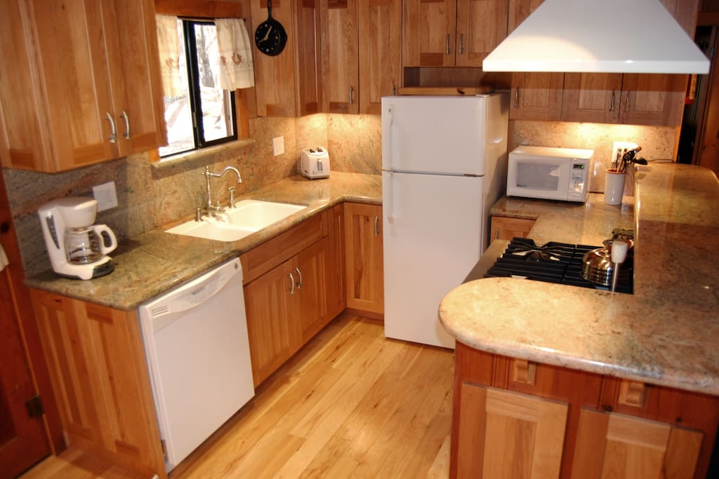Kitchen with a Viking gas range and convection oven