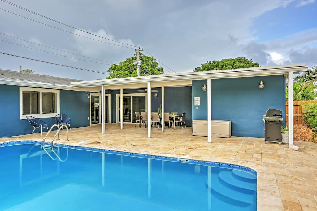 Soak up the Florida sun while lounging by the home's private heated swimming pool.