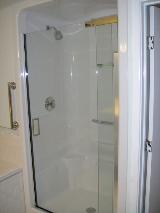 Large shower stall with ample room, even for big and tall guests.