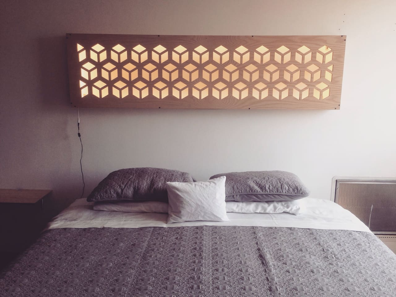 King size bed with warm white Led lamp designed and built by me.