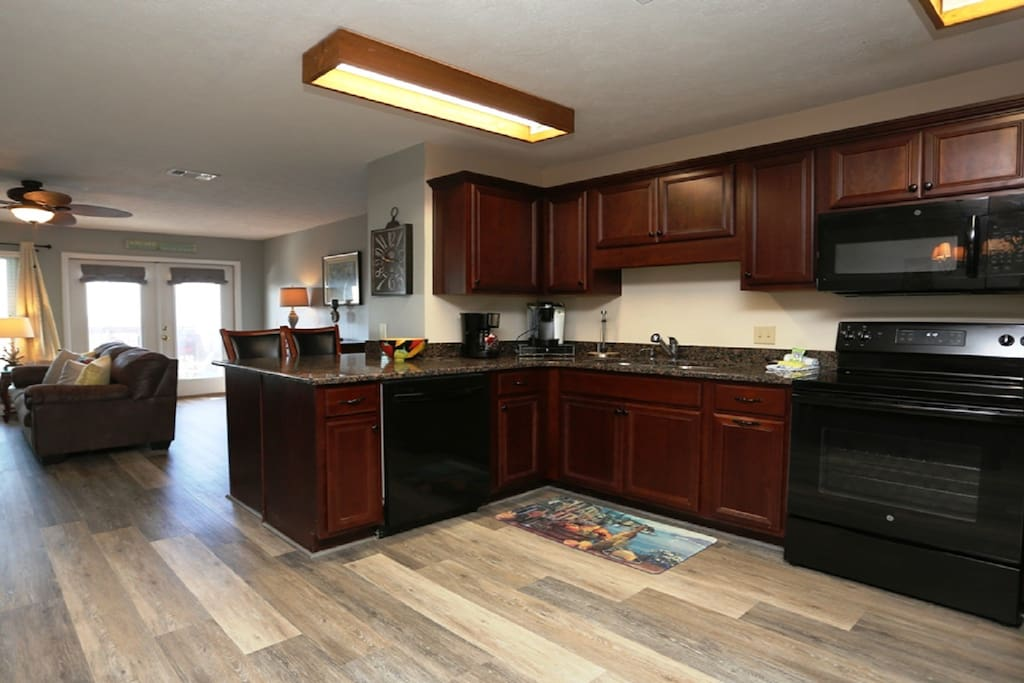 Kitchen with granite counters and custom cabinets