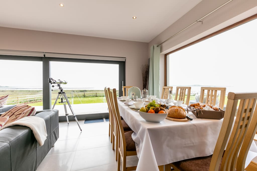 Getting ready for breakfast in the sun lounge. try out the telescope to see what you can spot across the lough.