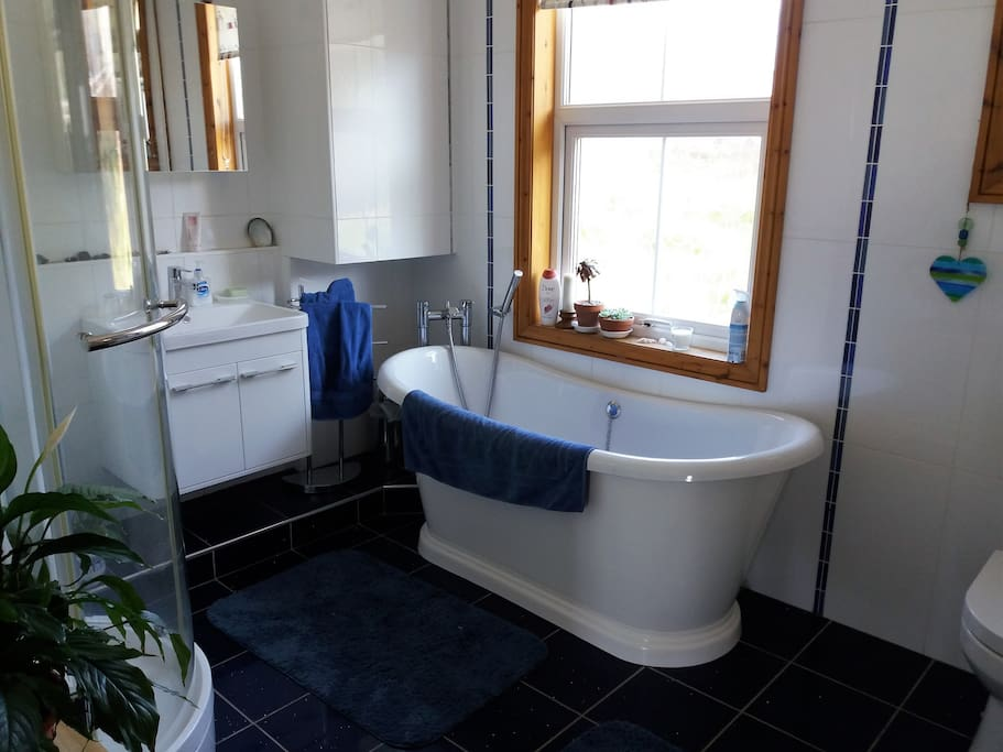 Spacious with separate shower cubicle.