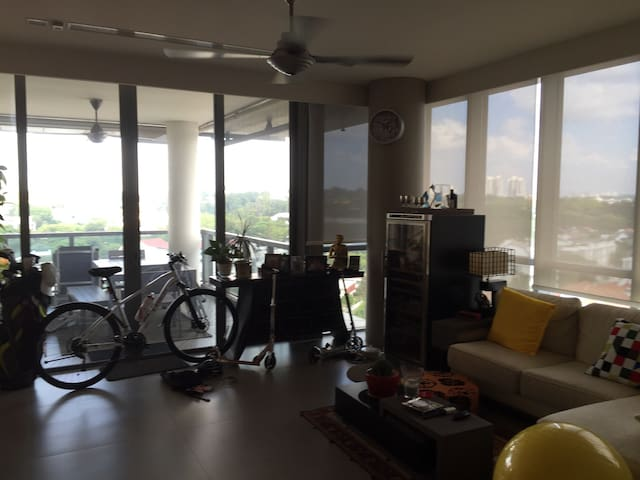 large living room area and ceiling to floor sliding balcony doors