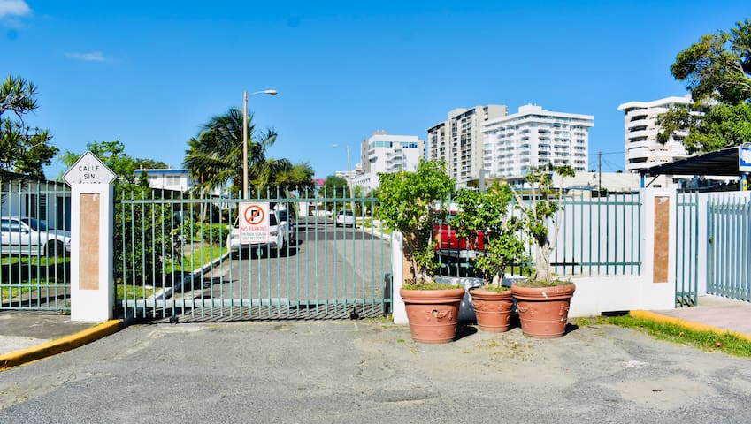 Gated entrance to the house with pedestrian gate.