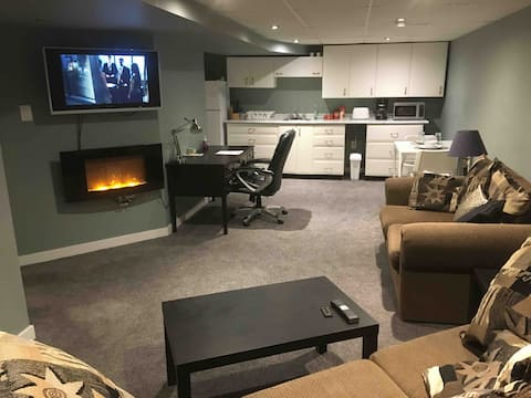 Super value, cozy space....Sit back in this comfy suite with a warm realistic fire and enjoy a movie....Nice!