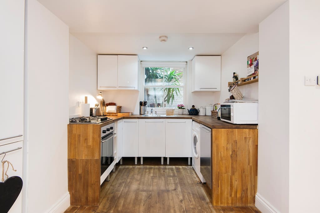 Fully fitted kitchen with washing machine, dishwasher, cooker, hob fridge/freezer and microwave.