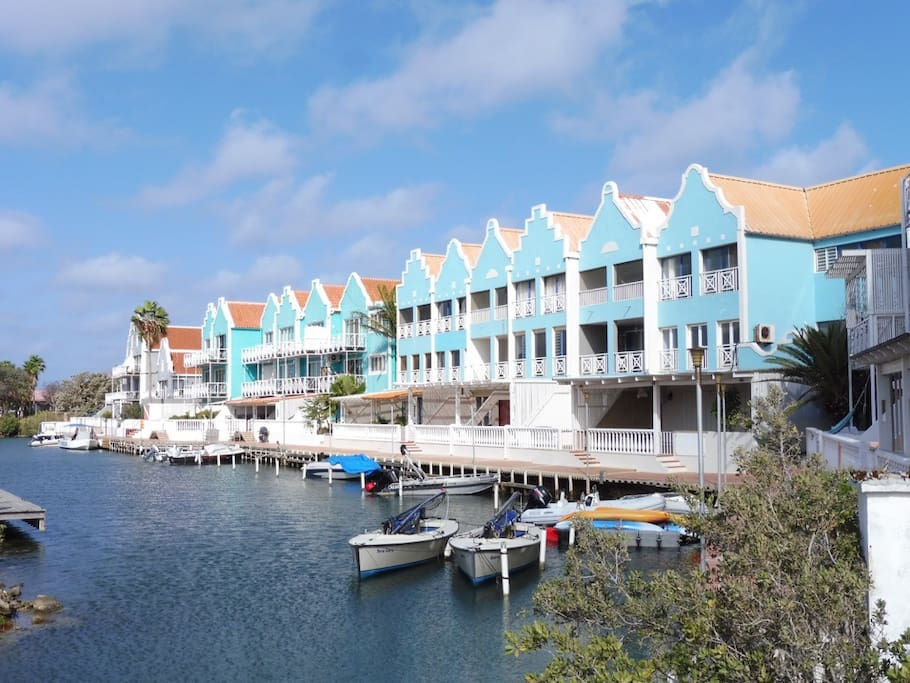 Breezy Loft is a very large, breezy apartment on the top floor at Caribbean Court.  It sleeps 7 people in real beds and is fully screened in for breezes day and night.  The apartment has sunrise views from the waterside terrace and sunset views from the terrace on the garden side.