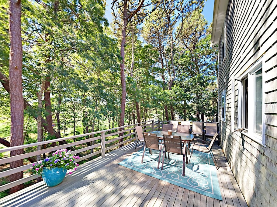 Spend peaceful afternoons on the deck overlooking the woods and scenic pond.