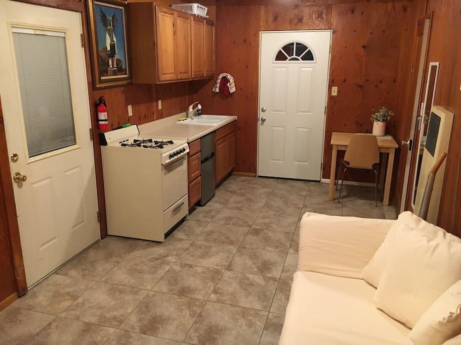 Kitchenette and back door that leads to backyard