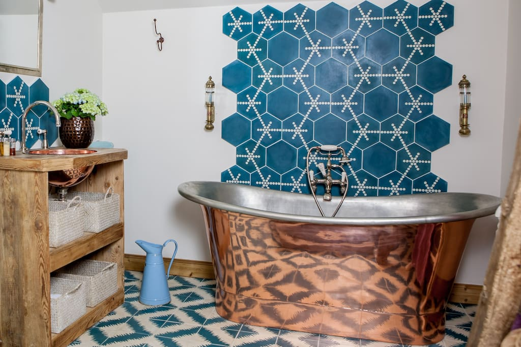 Bathroom One with large copper bath, wc and sink