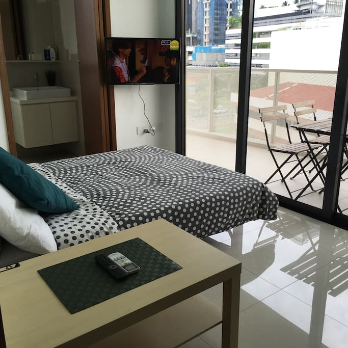 Double bed, coffee table, TV, large balcony, leisure furniture