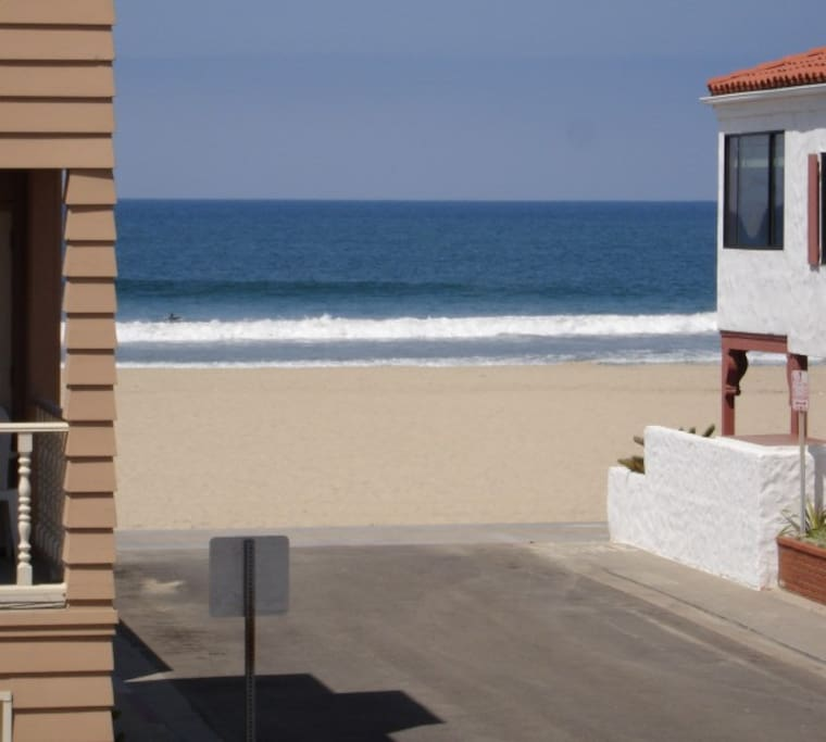 How close are we to the water? Just one house - or 30 steps - from your front door!